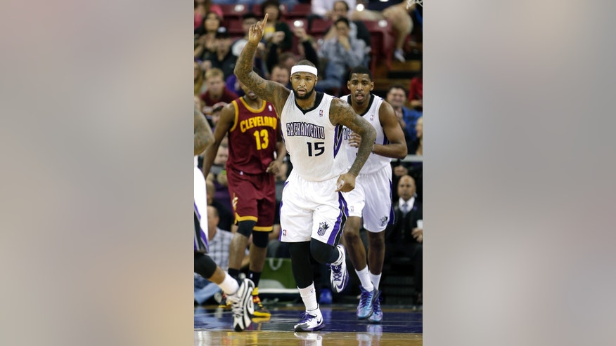 Sacramento Kings center DeMarcus Cousins gestures after scoring against the Cleveland Cavaliers during the first quarter of an NBA basketball game in Sacramento, Calif.,  Sunday, Jan. 12, 2014. (AP Photo/Rich Pedroncelli)