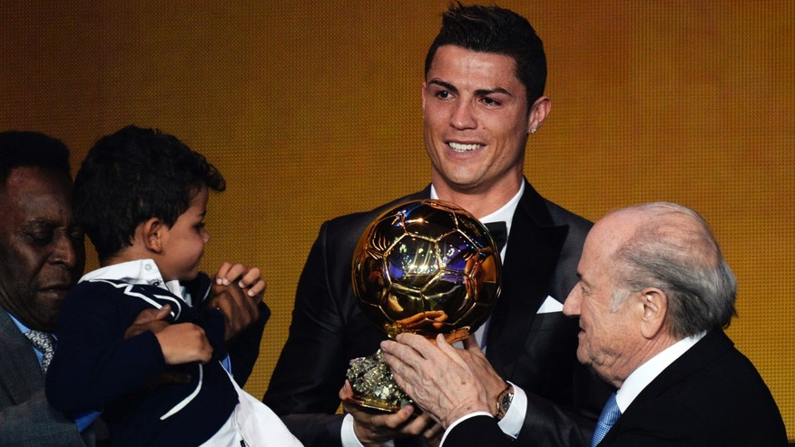 Cristiano Ronaldo of Portugal, center, is awarded the prize for the FIFA Men's soccer player of the year 2013 by FIFA President Sepp Blatter, right, and Pelé, left, at the FIFA Ballon d'Or 2013 gala at the Kongresshaus in Zurich, Switzerland, Monday, Jan. 13, 2014. (AP Photo, Keystone/Steffen Schmidt)