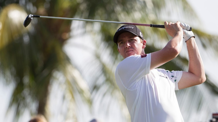 Jimmy Walker watches his drive off the 14th tee during the fourth round of the Sony Open golf tournament at Waialae Country Club, Sunday, Jan. 12, 2014, in Honolulu. (AP Photo/Eugene Tanner)