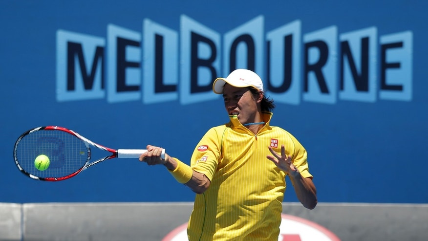 Kei Nishikori of Japan makes a forehand return to Marinko Matosevic of Australia during their first round match at the Australian Open tennis championship in Melbourne, Australia, Tuesday, Jan. 14, 2014.(AP Photo/Aaron Favila)