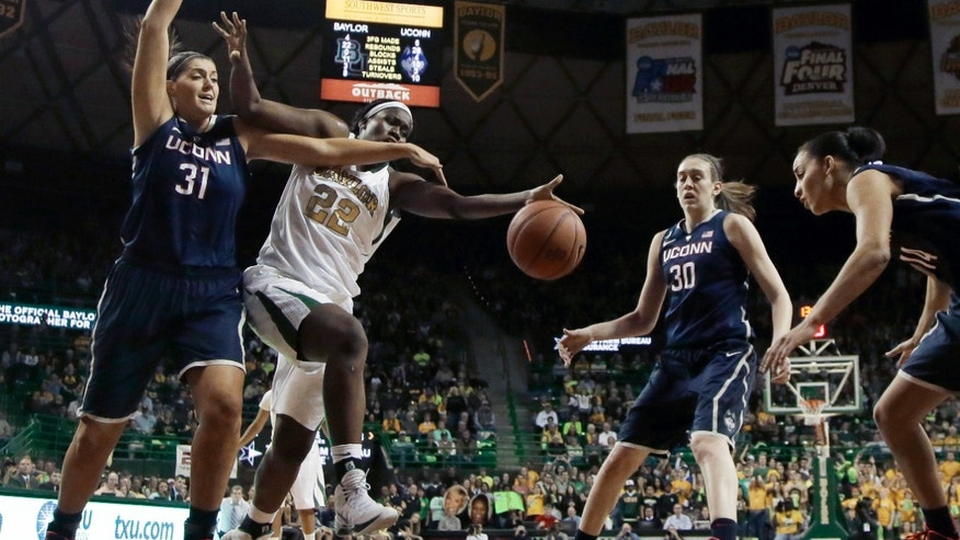 Connecticut's Stefanie Dolson (31), Breanna Stewart (30), and Bria Hartley, right, combine to win a rebound against Baylor's Sune Agbuke (22) in the second half of an NCAA college basketball game, Monday, Jan. 13, 2014, in Waco, Texas. Connecticut won 66-55. (AP Photo/Tony Gutierrez)