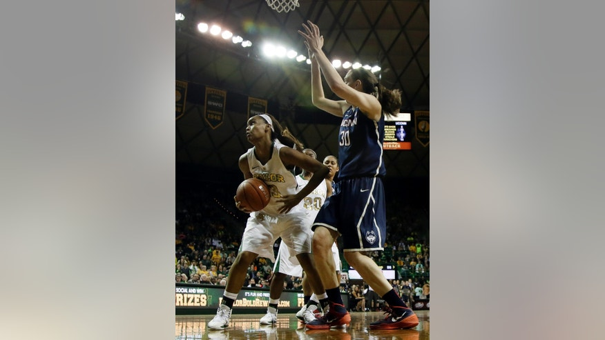 Baylor's Nina Davis (13) comes down with an offensive rebound in front of Connecticut's Breanna Stewart (30) in the second half of an NCAA college basketball game, Monday, Jan. 13, 2014, in Waco, Texas. Davis collected 17 rebounds in the 66-55 Baylor loss. (AP Photo/Tony Gutierrez)