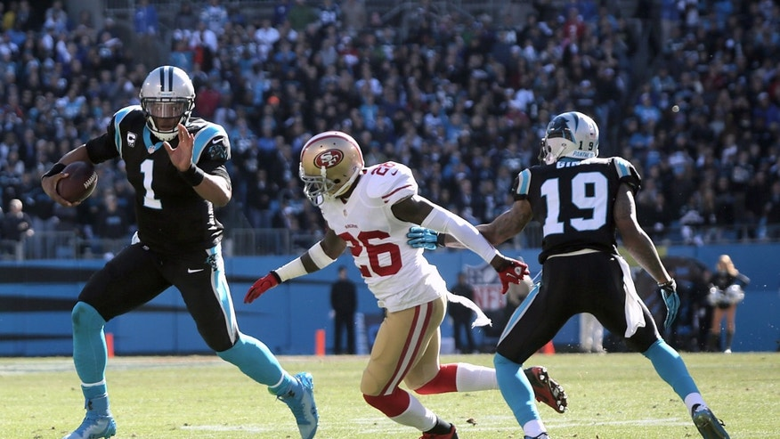 Carolina Panthers' quarterback Cam Newton (1) runs the ball around the San Francisco 49ers' Tramaine Brock (26) during a divisional playoff NFL football game, Sunday, Jan. 12, 2014, in Charlotte, N.C. (AP Photo/The Star, Ben Earp)
