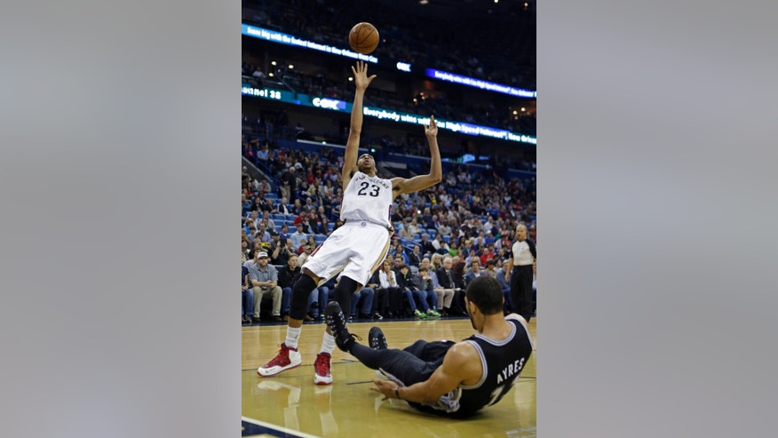New Orleans Pelicans power forward Anthony Davis (23) commits an offensive foul as he shoots against San Antonio Spurs power forward Jeff Ayres in the first half of an NBA basketball game in New Orleans, Monday, Jan. 13, 2014. (AP Photo/Gerald Herbert)