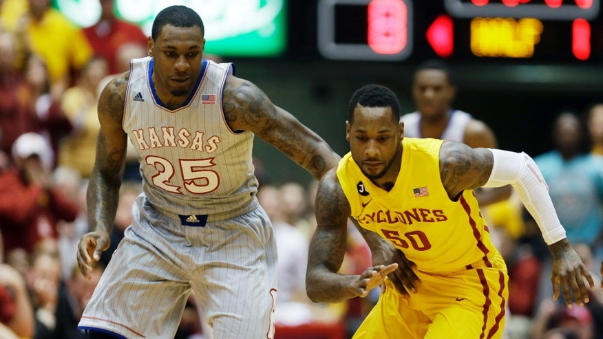 Iowa State guard DeAndre Kane, right, runs down a loose ball ahead of Kansas forward Tarik Black during the first half of an NCAA college basketball game, Monday, Jan. 13, 2014, in Ames, Iowa. (AP Photo/Charlie Neibergall)