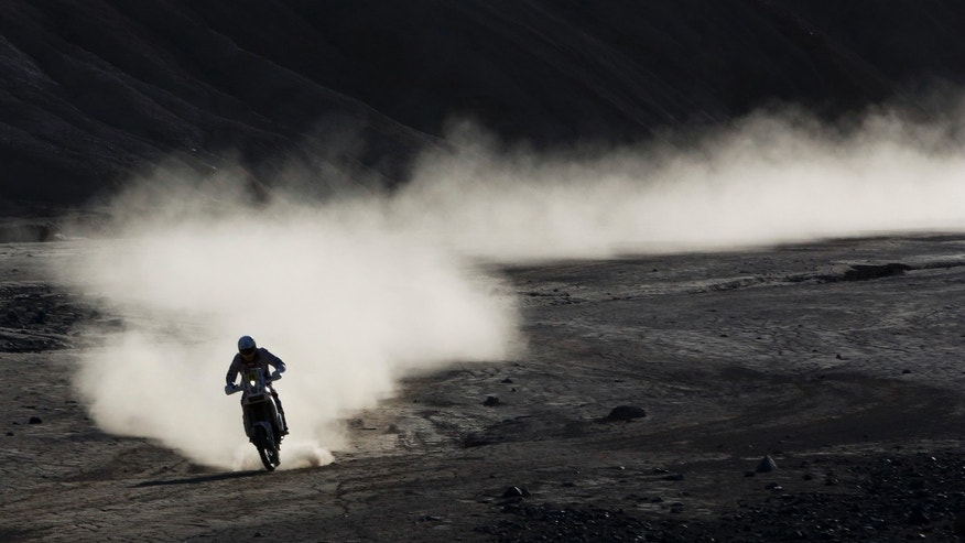 KTM Jakub Przygonski of Poland rides his motorcycle during the ninth stage of the Dakar Rally between the cities of Calama and Iquique, Chile, Tuesday, Jan. 14, 2014. (AP Photo/Victor R. Caivano)