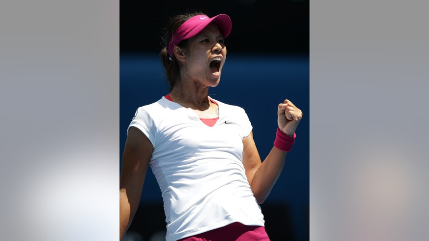 Li Na of China celebrates her win over Belinda Bencic of Switzerland in their second round match at the Australian Open tennis championship in Melbourne, Australia, Wednesday, Jan. 15, 2014.(AP Photo/Aaron Favila)