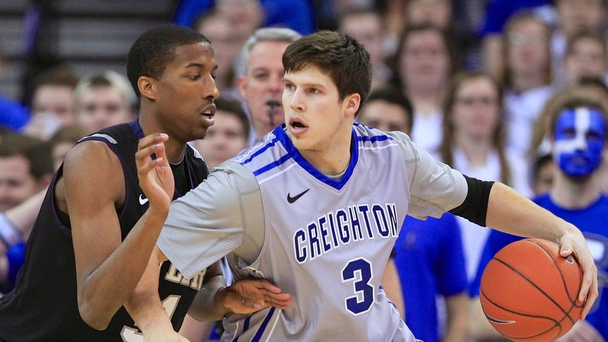 Creighton's Doug McDermott (3) is guarded by Butler's Kameron Woods (31) in the first half of an NCAA college basketball game in Omaha, Neb., Tuesday, Jan. 14, 2014. (AP Photo/Nati Harnik)