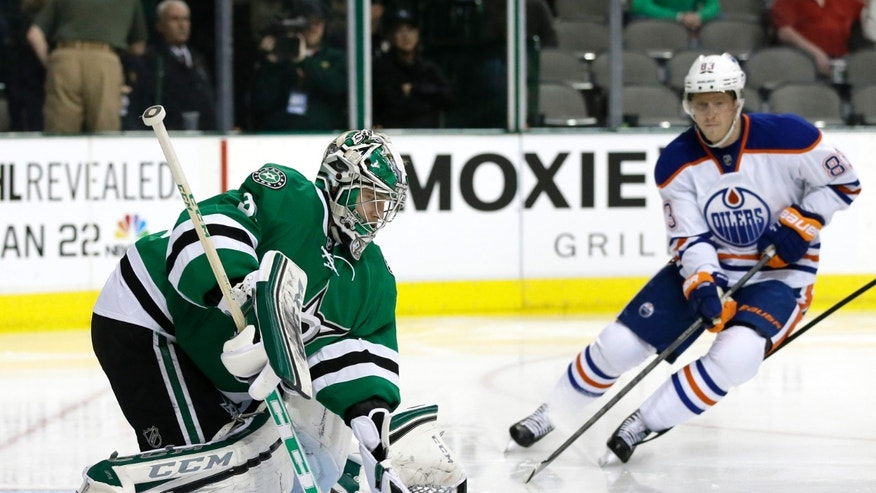 Dallas Stars' Kari Lehtonen (32) of Finland prepares to glove a shot under pressure from Edmonton Oilers right wing Ales Hemsky (83) of Czech Republic in the second period of an NHL Hockey game, Tuesday, Jan. 14, 2014, in Dallas. (AP Photo/Tony Gutierrez)