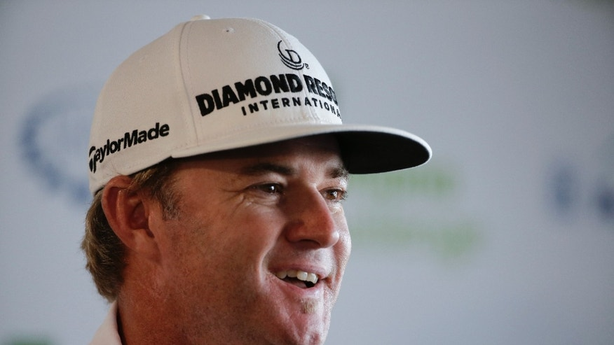 Brian Gay, last year's Humana Challenge golf tournament winner, smiles during a news conference at the tournament at PGA West on Wednesday, Jan. 15, 2014, in La Quinta, Calif. (AP Photo/Chris Carlson)