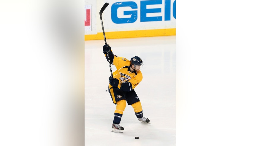 Nashville Predators defenseman Ryan Ellis winds up as he shoots and scores a goal against the Calgary Flames in the third period of an NHL hockey game, Tuesday, Jan. 14, 2014, in Nashville, Tenn. (AP Photo/Mark Humphrey)