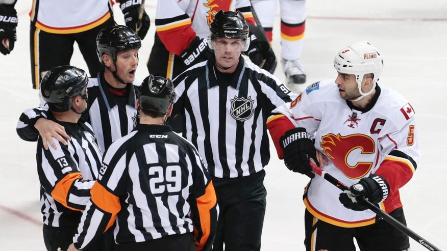 Calgary Flames defenseman Mark Giordano (5) argues with officials after they waved off an apparent goal by the Flames because it was hit with a high stick in the third period of an NHL hockey game against the Nashville Predators, Tuesday, Jan. 14, 2014, in Nashville, Tenn. (AP Photo/Mark Humphrey)