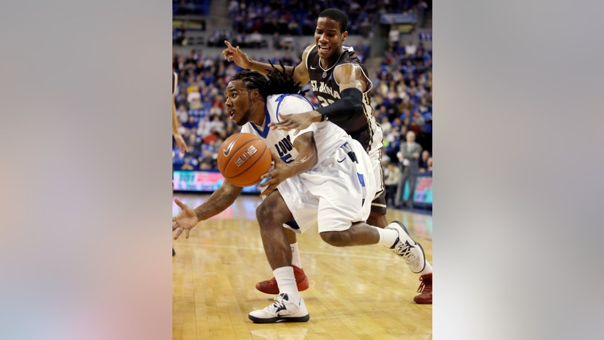 Saint Louis' Jordair Jett, left, is fouled on his way to the basket by St. Bonaventure's Andell Cumberbatch during the first half of an NCAA college basketball game Wednesday, Jan. 15, 2014, in St. Louis. (AP Photo/Jeff Roberson)