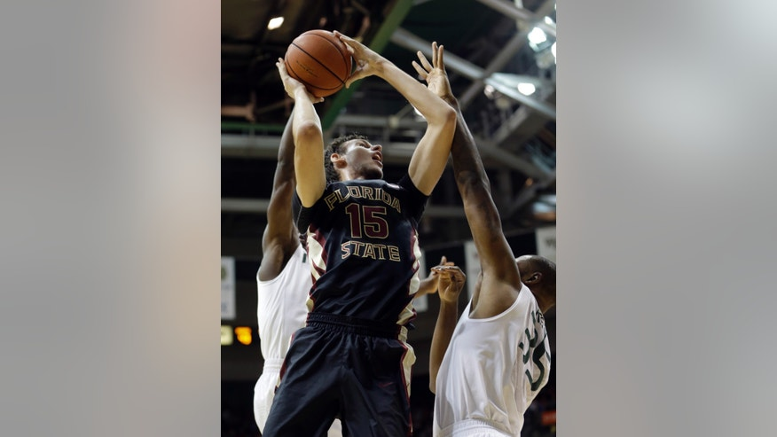 Florida State Boris Bojanovsky (15) goes up against Miami forward James Kelly (35) during the second half of an NCAA basketball game in Coral Gables, Fla., Wednesday, Jan. 15, 2014. Florida State won 63-53. (AP Photo/Alan Diaz)
