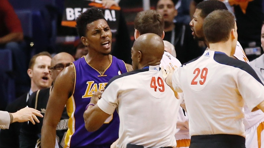 Los Angeles Lakers'Nick Young is separated from Phoenix Suns guard Goran Dragic after Young was fouled by Suns' Alex Len during the second quarter of an NBA basketball game Wednesday, Jan. 15, 2014, in Phoenix. (AP Photo/The Arizona Republic, Michael Chow) MESA OUT  MARICOPA COUNTY OUT  NO SALES