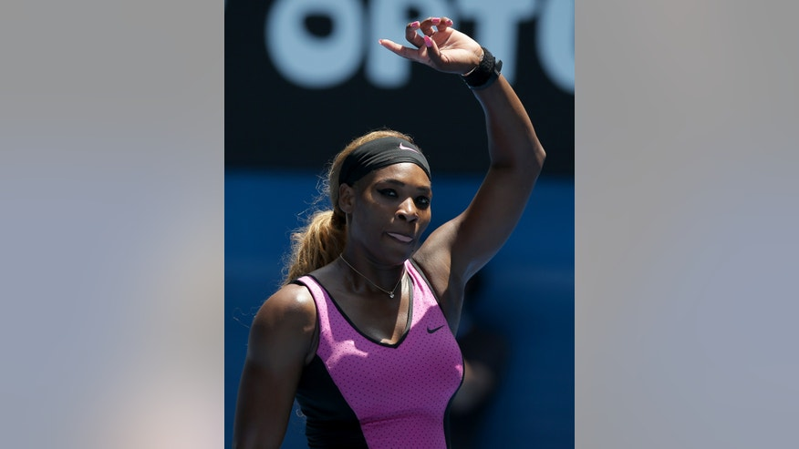 Serena Williams of the United States waves to the crowd after defeating Vesna Dolonc of Serbia in their second round match at the Australian Open tennis championship in Melbourne, Australia, Wednesday, Jan. 15, 2014.(AP Photo/Aaron Favila)