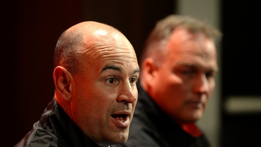 Jeremy Pruitt, left, speaks after being is introduced as Georgia's new defensive coordinator by head football coach Mark Richt, right, during an NCAA college football news conference on Wednesday, Jan. 15, 2014, in Athens, Ga. The former Florida State defensive coordinator, who helped lead the Seminoles to the 2013 BCS championship, said he would build relationships with Bulldog players to build their trust. (AP Photo/David Tulis)