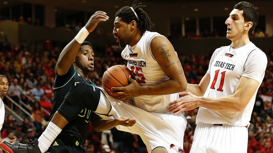 Texas Tech's Aaron Ross (15) grabs away a rebound from Baylor's Royce O'Neale as teammate Dejan Kravic(11) looks on during an NCAA college basketball game in Lubbock, Texas, Wednesday, Jan, 15, 2014. (AP Photo/Lubbock Avalanche-Journal, Tori Eichberger) ALL LOCAL TV OUT