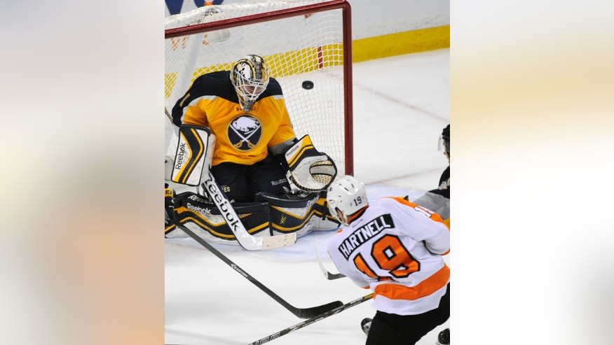 Buffalo Sabres goaltender Jhonas Enroth (1), of Sweden, is unable to stop a goal by Philadelphia Flyers left winger Scott Hartnell (19) during the third period of an NHL hockey game in Buffalo, N.Y., Tuesday, Jan. 14, 2014. Philadelphia won 4-3.  (AP Photo/Gary Wiepert)