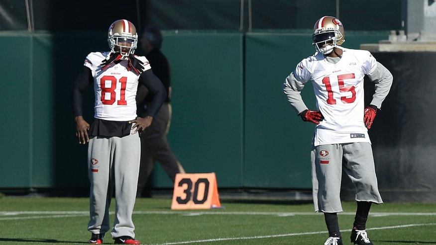 San Francisco 49ers wide receivers Anquan Boldin (81) and Michael Crabtree (15) take part in the NFL football team's practice in Santa Clara, Calif., Wednesday, Jan. 15, 2014. The 49ers are scheduled to play the Seattle Seahawks for the NFC championship on Sunday. (AP Photo/Jeff Chiu)