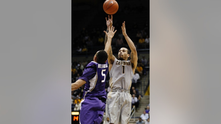 California's Justin Cobbs (1) shoots over Washington's Nigel Williams-Goss during the first half of an NCAA college basketball game, Wednesday, Jan. 15, 2014, in Berkeley, Calif.  (AP Photo/George Nikitin)