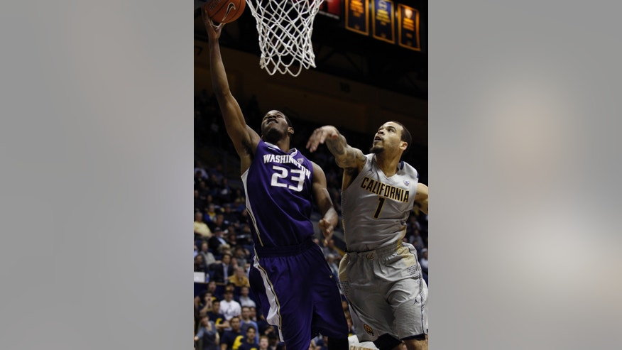 Washington's C.J. Wilcox (23) shoots as California's Justin Cobbs defends during the first half of an NCAA college basketball game, Wednesday, Jan. 15, 2014, in Berkeley, Calif.  (AP Photo/George Nikitin)