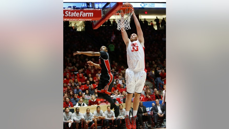 New Mexico's Alex Kirk dunks (53) in front of UNLV's Kevin Olekaibe in the first half of an NCAA college basketball game on Wednesday, Jan. 15, 2014, in Albuquerque, N.M. (AP Photo/Eric Draper)