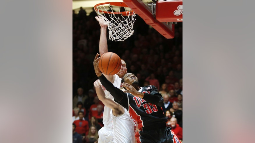 UNLV's Deville Smith (33) tries to score in front of New Mexico's Alex Kirk in the first half of an NCAA college basketball game on Wednesday, Jan. 15, 2014, in Albuquerque, N.M. (AP Photo/Eric Draper)