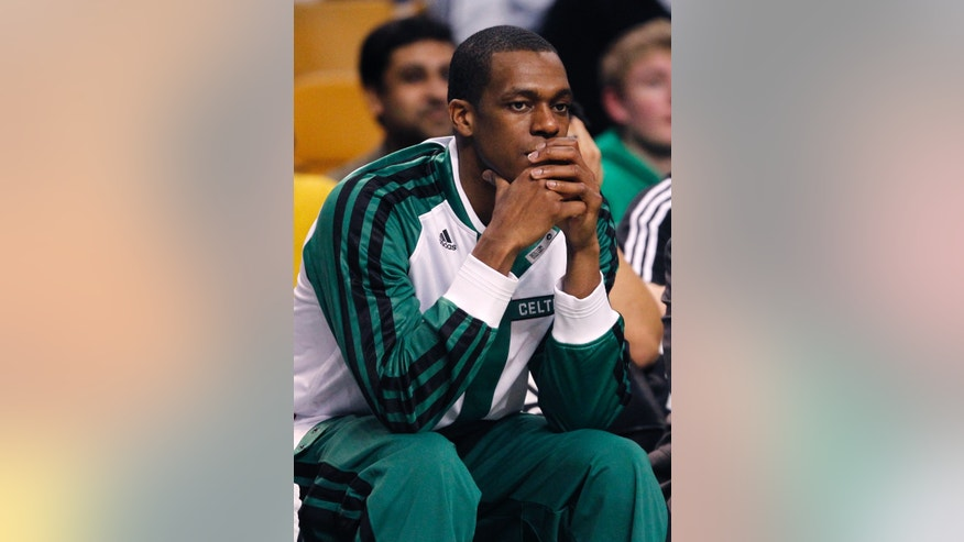 Boston Celtics guard Rajon Rondo watches from the bench during the first quarter of an NBA basketball game against the Toronto Raptors in Boston, Wednesday, Jan. 15, 2014. Rondo took a step toward returning to action on Wednesday, working out with members of Boston's NBA Development League team at the Celtics' practice facility earlier in the day. (AP Photo/Charles Krupa)