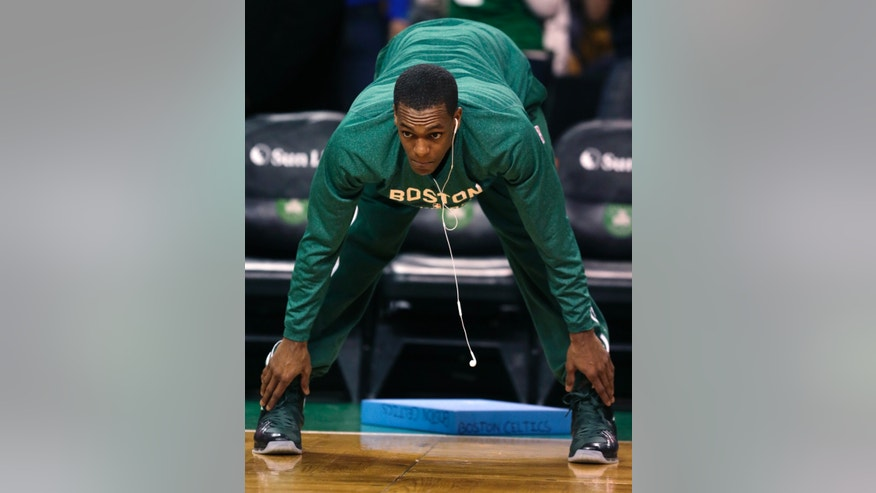 Boston Celtics guard Rajon Rondo stretches prior to an NBA basketball game against the Toronto Raptors, in Boston, Wednesday, Jan. 15, 2014. Rondo took a step toward returning to action on Wednesday, working out with members of Boston's NBA Development League team at the Celtics' practice facility earlier in the day. (AP Photo/Charles Krupa)