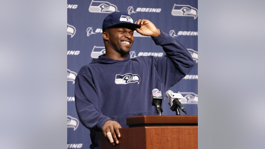 Seattle Seahawks defensive end Cliff Avril laughs as he begins an NFL football news conference Monday, Jan. 13, 2014, in Renton, Wash. The Seahawks play the San Francisco 49ers Sunday in the NFC championship game. (AP Photo/Elaine Thompson)