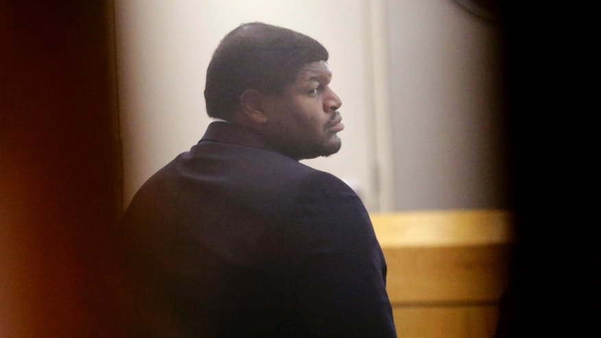 Former Dallas Cowboy Josh Brent stands in court during his trial for intoxication manslaughter, Wednesday, Jan. 15, 2014, in Dallas. Brent is accused of driving drunk at the time of a December 2012 crash that killed Cowboys practice squad player Jerry Brown. (AP Photo/LM Otero)
