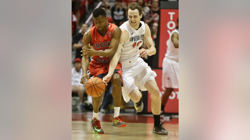 San Diego State forward Matt Shrigley battles Fresno State guard Allen Huddleston for a loose ball during the second half of San Diego State's 68-60 victory in a NCAA college basketball game Wednesday, Jan. 15, 2014, in San Diego. (AP Photo/Lenny Ignelzi)