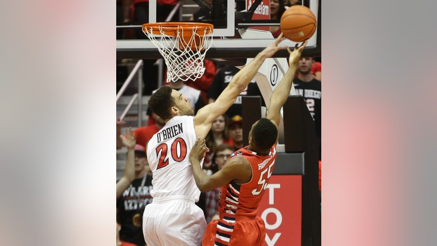 San Diego State forward JJ O'Brien blocks the shot of Fresno State guard Allen Huddleston during the second half of State's 68-60 victory in a NCAA college basketball game Wednesday, Jan. 15, 2014, in San Diego. (AP Photo/Lenny Ignelzi)