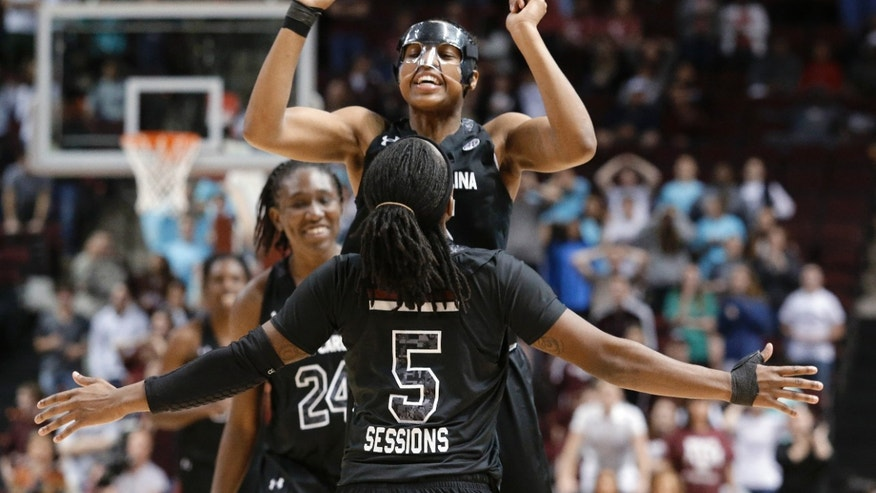 South Carolina guard Tiffany Mitchell (25) is congratulated by teammate Khadijah Sessions (5) after she hit a 3-pointer to tie the game with 5.1 seconds left in the second half of an NCAA women's basketball game against Texas A&M, Thursday, Jan. 16, 2014, in College Station, Texas. (AP Photo/Patric Schneider)