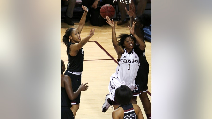 Texas A&M's Courtney Williams (1) takes a shot during the first half of an NCAA women's basketball game against South Carolina, Thursday, Jan. 16, 2014, in College Station, Texas. (AP Photo/Patric Schneider)