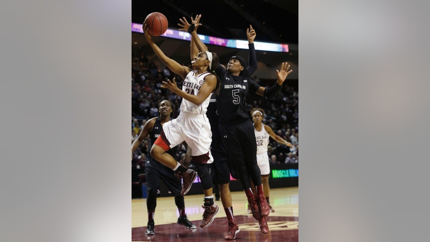 Texas A&M's Jordan Jones (24) shoots over South Carolina's Khadijah Sessions (5) during the first half of an NCAA women's basketball game, Thursday, Jan. 16, 2014, in College Station, Texas. (AP Photo/Patric Schneider)