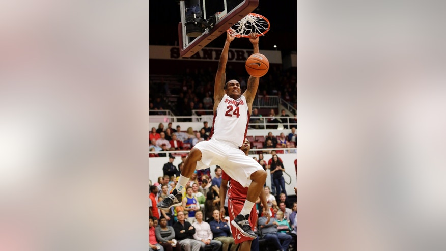 Stanford's Josh Huestis (24) dunks against Washington State during the second half of an NCAA college basketball game Wednesday, Jan. 15, 2014, in Stanford, Calif. (AP Photo/Marcio Jose Sanchez)