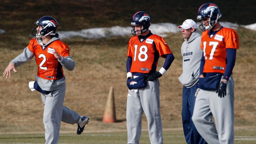 Denver Broncos offensive coordinator Adam Gase, second from right, watches as Broncos quarterbacks Zac Dysert (2), Payton Manning (18) and Brock Osweiler (17) workout during NFL football practice at the team's training facility in Englewood, Colo., on Thursday, Jan. 16, 2014. The Broncos are scheduled to host the New England Patriots on Sunday for the AFC championship. (AP Photo/Ed Andrieski)
