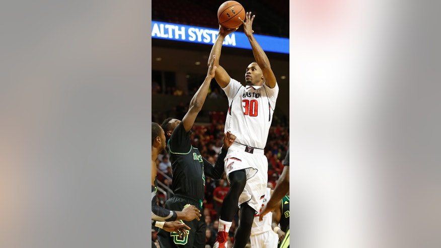 Texas Tech's Jaye Crockett (30) shoots over Baylor's Gary Franklin during an NCAA college basketball game in Lubbock, Texas, Wednesday, Jan, 15, 2014. (AP Photo/Lubbock Avalanche-Journal, Tori Eichberger) ALL LOCAL TV OUT