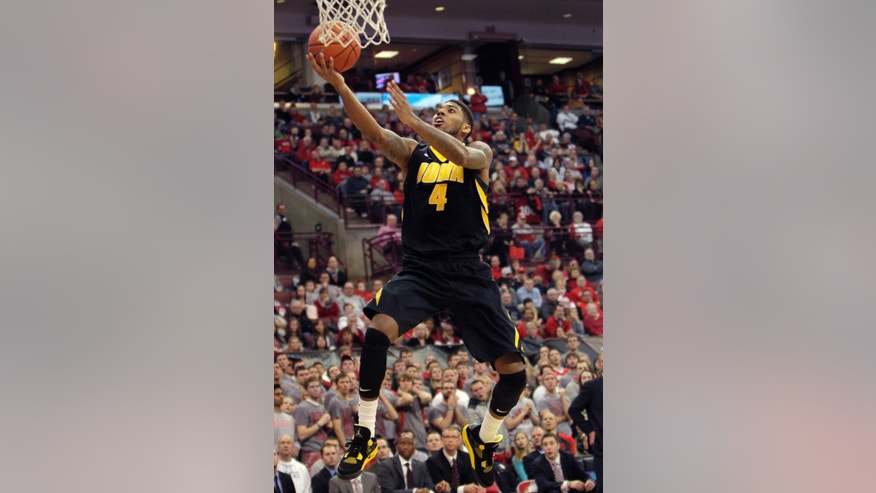 FILE - In this Jan. 12, 2014, file photo, Iowa's Roy Devyn Marble goes to the basket during an NCAA college basketball game against Ohio State in Columbus, Ohio. Marble has evolved into one of the Big Ten's top offensive threats.  (AP Photo/Jay LaPrete, File)