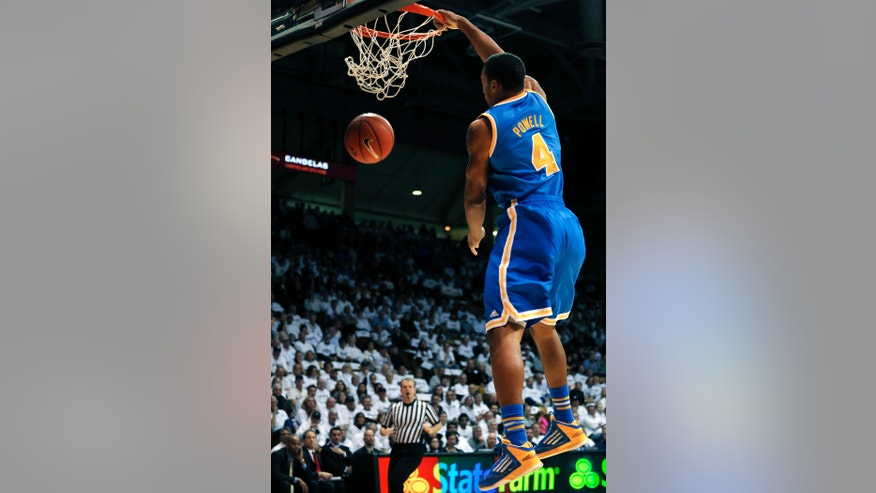 UCLA's Norman Powell dunks during the first half of an NCAA college basketball game against Colorado in Boulder, Colo., Thursday, Jan. 16, 2014. (AP Photo/Brennan Linsley)