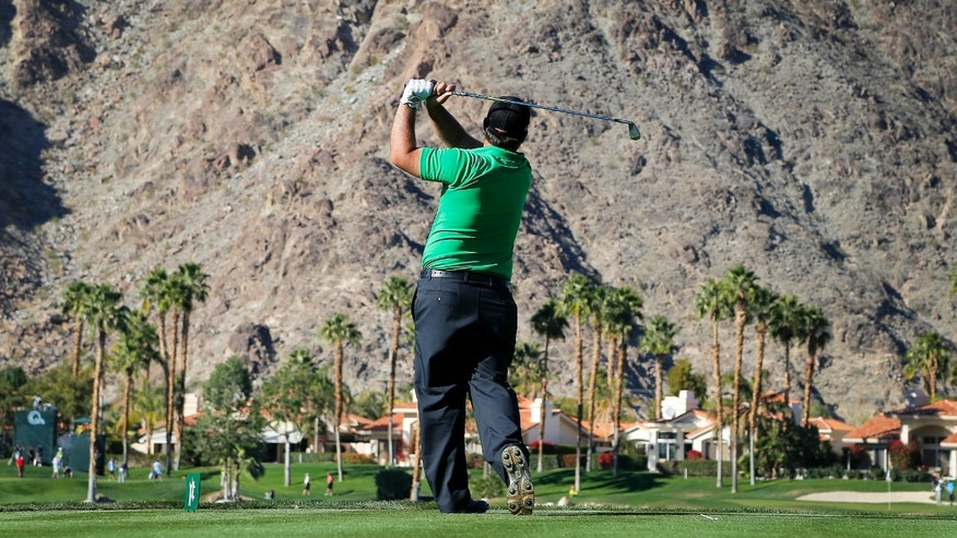 Patrick Reed hits from the fifth tee during the first round of the Humana Challenge PGA golf tournament on the Palmer Private course at PGA West, Thursday, Jan. 16, 2014, in La Quinta, Calif. (AP Photo/Matt York)