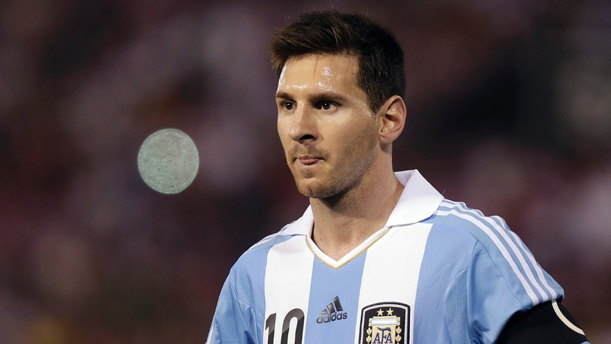 FILE - The Sept. 10, 2013 file photo shows Argentina's Lionel Messi on during a 2014 World Cup qualifying soccer game against Paraguay in Asuncion, Paraguay. Messi is one of the three candidates as the world's best soccer player  to be awarded at the FIFA Ballon d'Or gala on Monday, Jan 13, 2014. (AP Photo/Andre Penner, file)