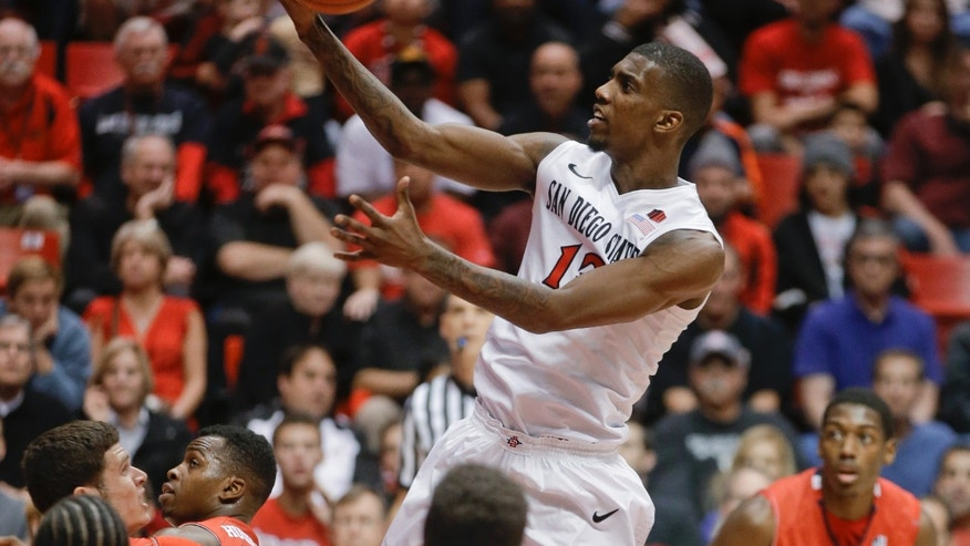 San Diego State forward Winston Shepard goes in for a layup during the first half of San Diego State's NCAA college basketball game against Fresno State on Wednesday, Jan. 15, 2014, in San Diego. (AP Photo/Lenny Ignelzi)