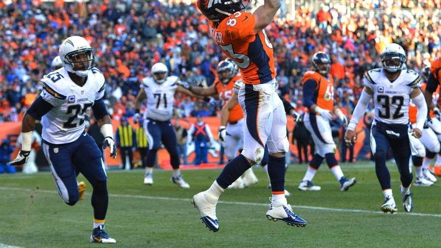 Denver Broncos wide receiver Wes Welker (83) catches a pass for a touchdown against the San Diego Chargers in the second quarter of an NFL AFC division playoff football game, Sunday, Jan. 12, 2014, in Denver. (AP Photo/Jack Dempsey)