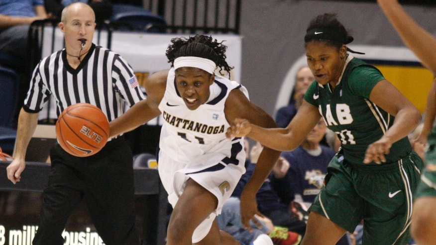 In this Nov. 21, 2013 photo, Chattanooga guard Ka'Vonne Towns, center, dribbles ahead of UAB guard Janeka Williams, right, during an NCAA college basketball game in Chattanooga, Tenn. Chattanooga may not be nationally recognized as a women's college basketball power, but its 32-game home winning streak is the longest in the game, and includes wins over Southeastern Conference programs Tennessee, Auburn and Alabama. (AP Photo/Chattanooga Times Free Press, Doug Strickland) THE DAILY CITIZEN OUT; NOOGA.COM OUT; CLEVELAND DAILY BANNER OUT; LOCAL INTERNET OUT