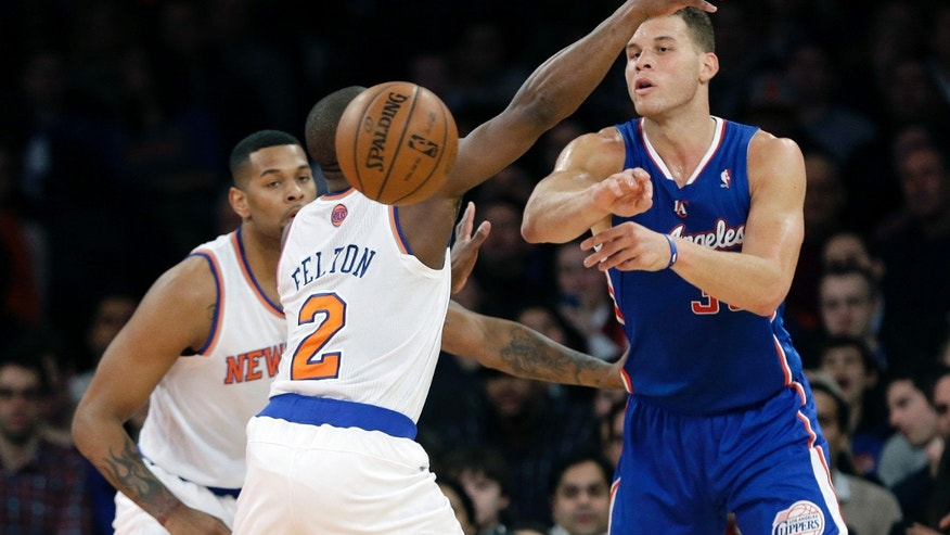 Los Angeles Clippers' Blake Griffin, right, passes away from New York Knicks' Raymond Felton (2) during the first half of an NBA basketball game, Friday, Jan. 17, 2014, in New York. (AP Photo/Frank Franklin II)