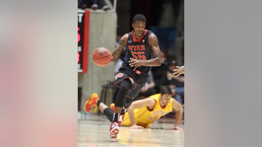 Utah's Delon Wright (55) brings the ball up court as Southern California's Omar Oraby, right, of Egypt, looks on in the second half during an NCAA basketball game Thursday, Jan. 16, 2014, in Salt Lake City.  Utah won 84-66.  (AP Photo/Rick Bowmer)