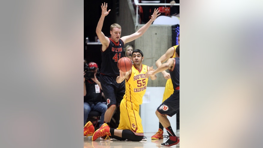 Southern California's Omar Oraby (55), of Egypt, passes the ball as Utah's Jeremy Olsen (41) defends in the second half during an NCAA basketball game Thursday, Jan. 16, 2014, in Salt Lake City. Utah won 84-66. (AP Photo/Rick Bowmer)
